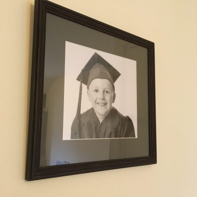 A Black Shabby Step Frame with School Grey Mount - perfect for a handsome graduate! By Telford Picture Framer