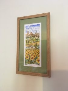Italian Artwork of Sunflowers in Tuscany with a Laurel Mount and Natural Oak Frame by Telford Picture Framer